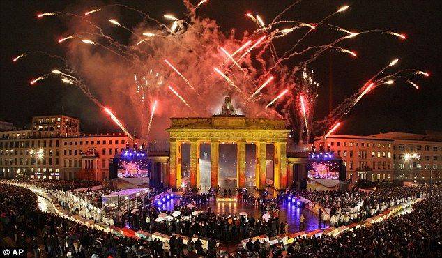 Fireworks illuminate the Brandenburg Gate in Berlin on the 20th anniversary in 2009